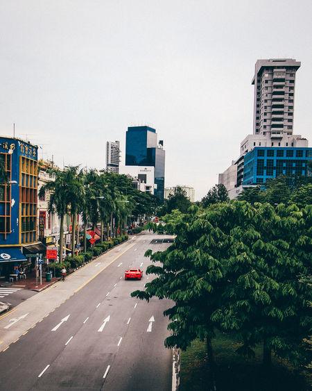 Vehicles on road against buildings