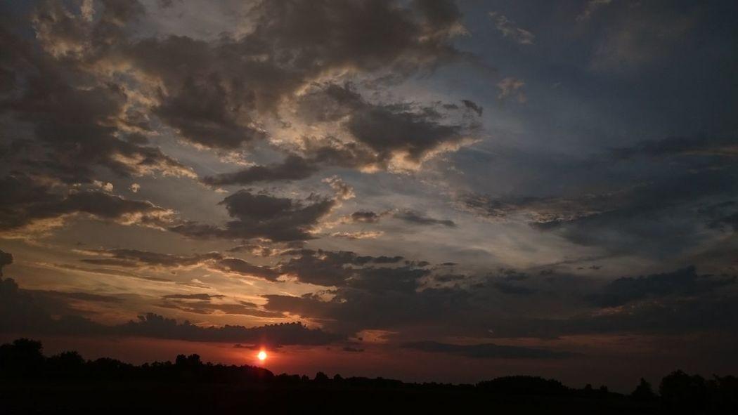 Beauty In Nature Cloud Cloud - Sky Cloudy Dark Dramatic Sky Idyllic Landscape Majestic Moody Sky Nature Non Urban Scene Orange Color Scenics Silhouette Sky Sun Sunbeam Sunset Tranquil Scene Tranquility