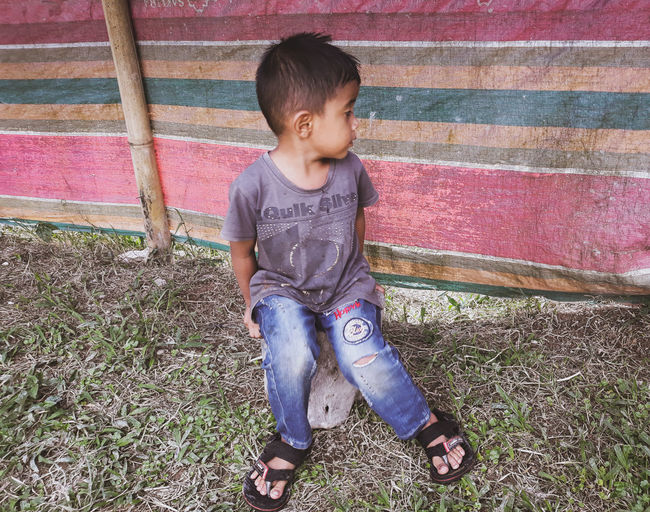 High angle view of boy looking at camera