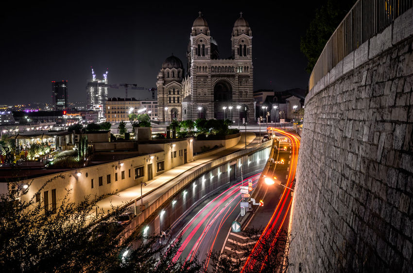 Architecture Building Exterior Built Structure City Cityscape Illuminated Light Trail Long Exposure Motion Night No People Outdoors Sky Speed Transportation
