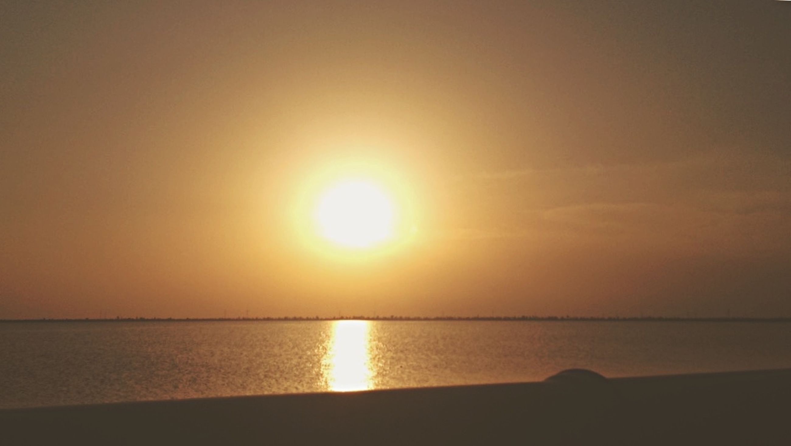 sun, sunset, sea, scenics, beauty in nature, nature, water, tranquil scene, tranquility, reflection, idyllic, silhouette, sunlight, bright, sky, horizon over water, beach, no people, horizon, outdoors
