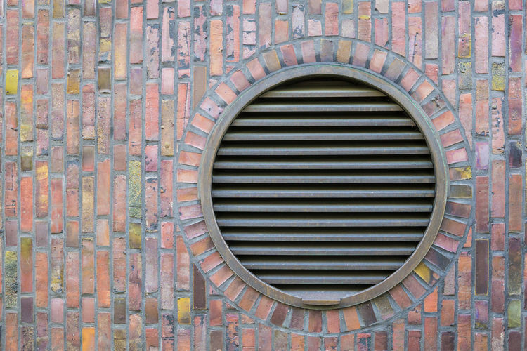 Round ventilation shaft exit on an old brick stone facade in Hamburg, Germany 8ung Hamburg Architecture Brick Wall Building Building Exterior Circle City Europe Geometric Shape Germany Hamburg No People Old Pattern Stone Wall Urban Ventilation Wall - Building Feature