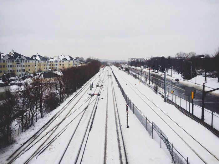 High angle view of snow covered railway track