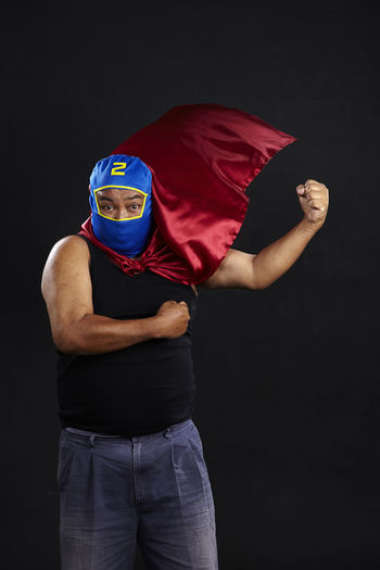 old man with cape and mask as a superhero, Adult Asian  Brave Cape Town Funny HERO Leader Obesity Red Retired Super Superhero Costume Elderly Male Mask Muscle Overweight Portrait Powerful Protector Senior Strength