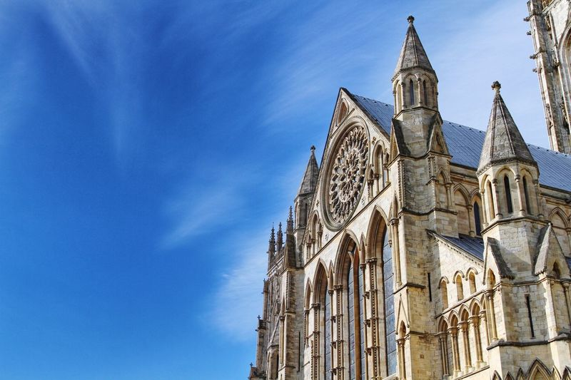 Low Angle View Of York Minster Against Blue Sky