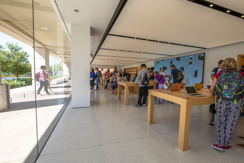 Cupertino, California, United States - August 15, 2016: the Apple world headquarters at One Infinite Loop. Apple is a multinational that produces consumer electronics, personal computers and software. people come from the popular Apple store of Apple Inc Headquarters at One Infinite Loop located in Cupertino, Silicon Valley, California. Apple California IT Mac PC United States Adult Architecture Building Computer Cupertino Day Electronics Industry Flag Full Length Headquarter Headquarters Hq IMac27 IPhone Imac Indoors  Infinite Loop Large Group Of People Leisure Activity Lifestyles Men Mobile Modern People Real People Standing Store Student Walking Women