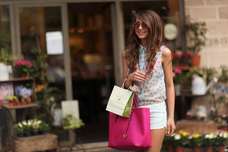 Beautiful Young Woman With Pink Handbag Walking Outdoors