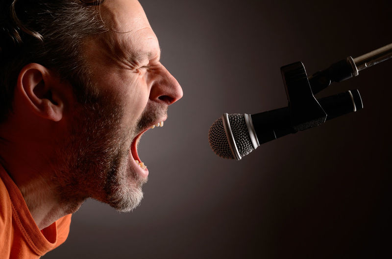 Say it loud !!! Adult Adults Only Beard Black Background Close-up Indoors  Loud Men Message Microphone Music Musician One Man Only One Person Only Men People Recording Studio Say Cheese Say It Without Words Side View Singer  Singing Studio Shot