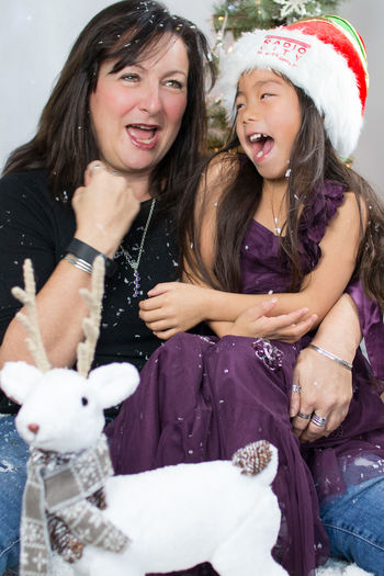 happy together Beauty Celebration Christmas Christmas Portrait Couple Cute Festive Fun Festive Season Friendship Girls Happiness Holiday - Event Laughing Mother And Daughter Only Women Outdoors Party - Social Event Real People Streamzoofamily Winter