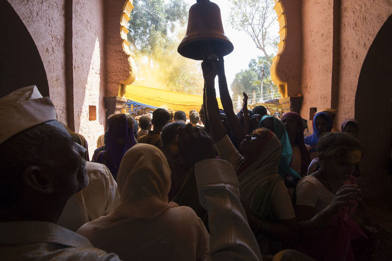 People sitting in temple against sky