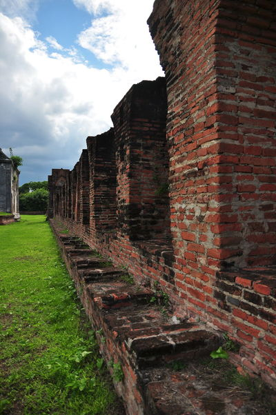 The ruins of the old palace in Lop Buri, Thailand. Archaeological Site Castle Thailand The Palace  Ancient Civilization Architecture Brick Wall Building Exterior Built Structure Cloud - Sky Columns Day Grass History Lychen Moisture Moss Nature No People Old Ruin Outdoors Sanctuary  Scope Sky Structure