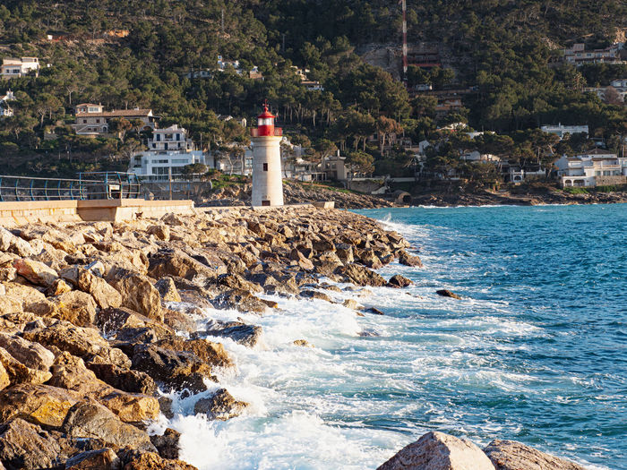 Lighthouse at harbor entrance. mallorca port de andratx sunset in mallorca. beautiful, landmark.