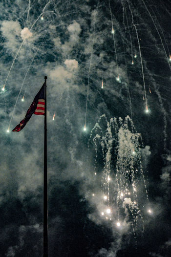 Illuminated Outdoors No People Sky Awe Low Angle View Long Exposure Arts Culture And Entertainment Event Exploding Night Firework - Man Made Object Celebration Firework Display Stars And Stripes Flag Close-up Patriotism Celebration Event Holiday - Event Explosive Fireball