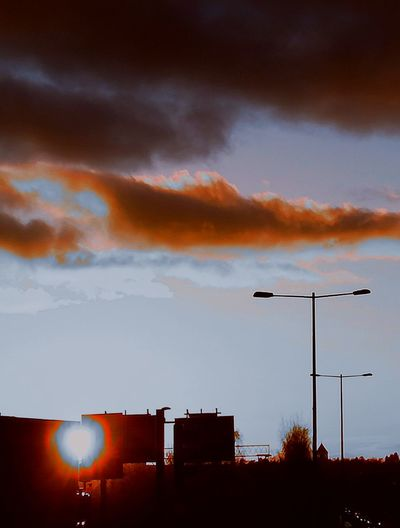 'LOST IN A SCENE' Streetlights Sign Signs Sunset Sunbeam Rays Mood Sundown Afternoon EyeEm Selects Sunset Silhouette Red Sky Cloud - Sky Dramatic Sky Atmospheric Mood Moody Sky Cloudscape Scenics Romantic Sky