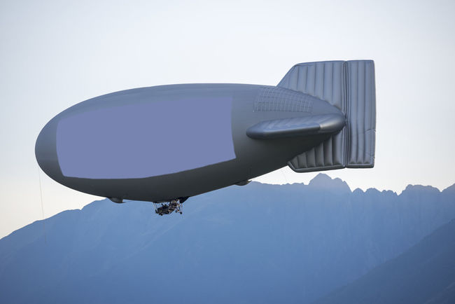 Blimp with copy space Air Vehicle AirBalloon Blimp Clear Sky Close-up Color Copy Space Day Dusk Empty Signboard Flying Full Frame Inflatable  Mid Air Mode Of Transport Mountain Mountain Range Nature No People On The Move Outdoors Sky Swiss Alps Technology Transportation