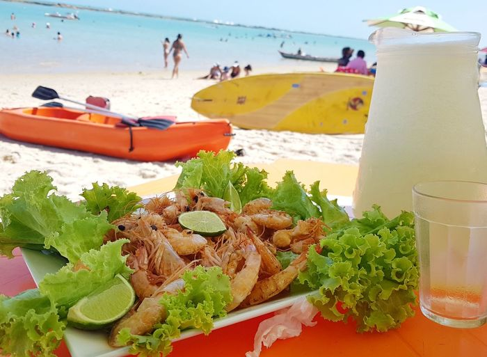 Close-up of food on table at beach