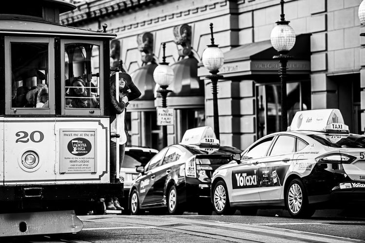 """""""The best way to travel"""" Mobility In Mega Cities Architecture Building Exterior Built Structure Car City City Life City Street Day In Front Of Land Vehicle Mode Of Transport Parking Road Stationary Street Transportation Travel Destinations The Street Photographer - 2017 EyeEm Awards"""
