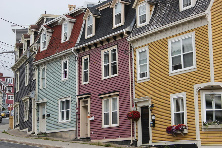 Jelly Bean houses are a tourist attraction in this part of Newfoundland and it is a good site to see! Architecture Building Exterior Built Structure City City Life Jelly Bean Hou Jelly Bean House Newfoundland Newfoundland, Canada Old Stuff Residential Structure St Johns Street Streetphotography