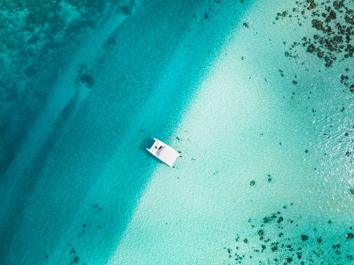 a ship in the lagoon of moorea French Polynesia Pacific Travel Blue Day High Angle View Lagoon Lagoon Water Land Nature Nautical Vessel Outdoors Sea Sunlight Tahiti Tranquility Transportation Travel Destinations Turquoise Colored Water The Great Outdoors - 2018 EyeEm Awards 17.62°