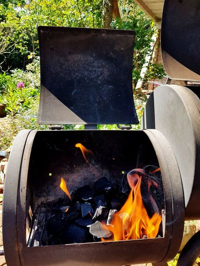 High angle view of fire on barbecue grill