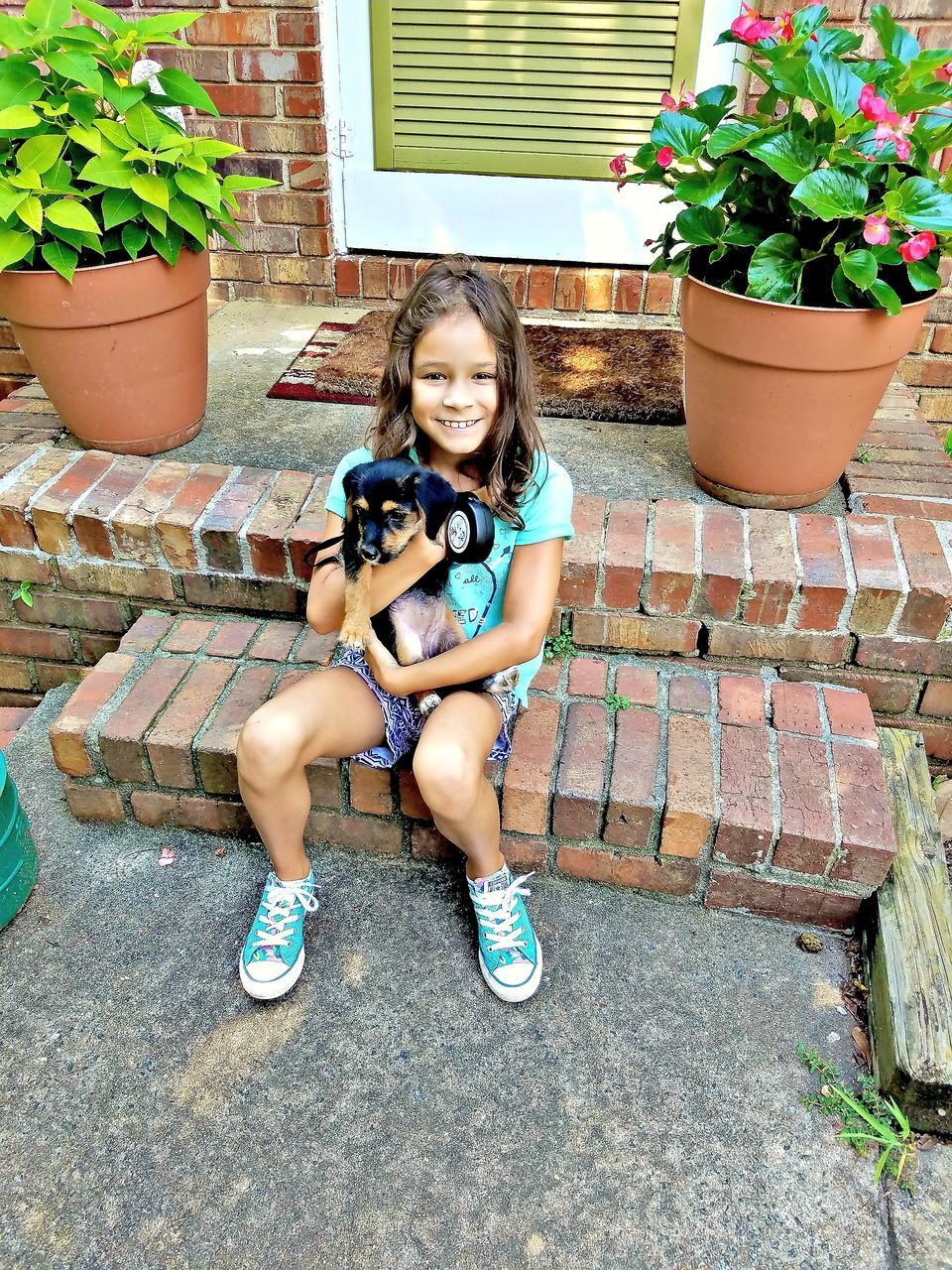 Portrait Of Girl With Dog Sitting On Steps