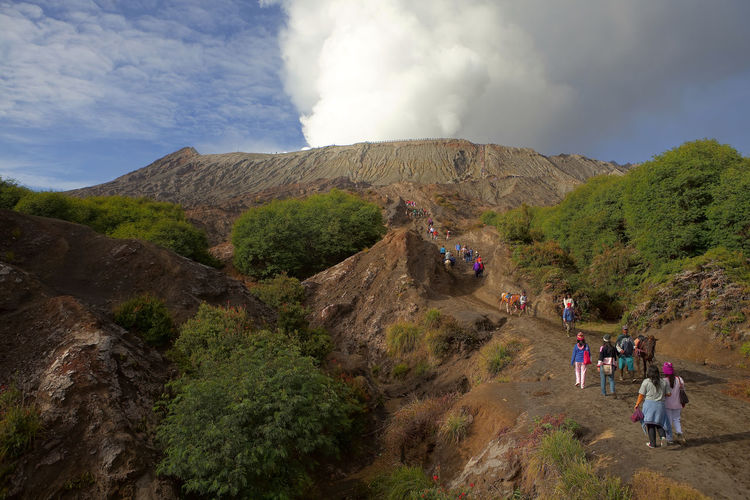Tourists Hiking Towards Volcano