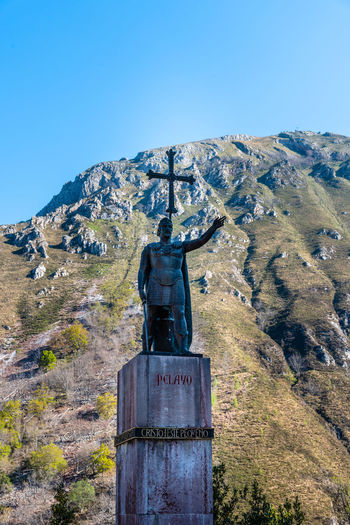 The statue of King Pelayo the first king of Spain Architecture Day No People Nature Reconquest Covadonga Asturias Asturias Paraiso Natural🌿🌼🌊🌞 SPAIN Europe Pilgrimage Basilica Landmark Pelayo  Statue Monument Sculpture Battle Of Covadonga Sky Human Representation Representation Male Likeness Art And Craft Clear Sky Blue Religion Mountain Military Memorial The Past Outdoors