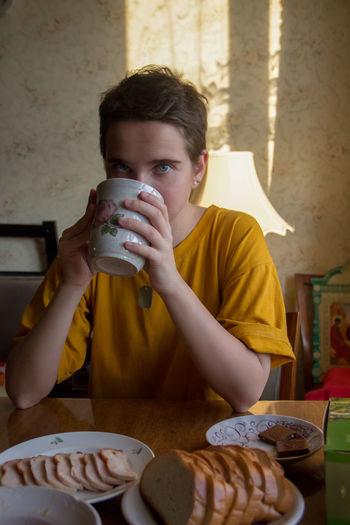 Portrait of a boy drinking coffee