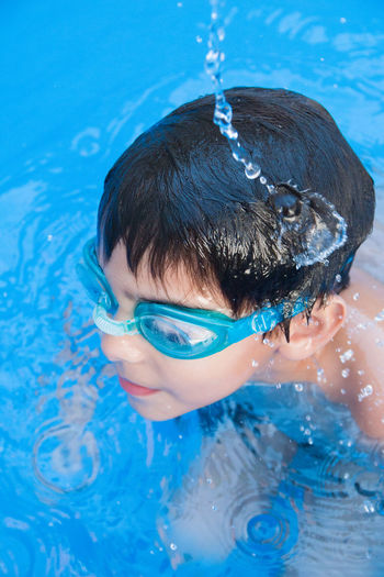 High angle view of boy swimming in pool