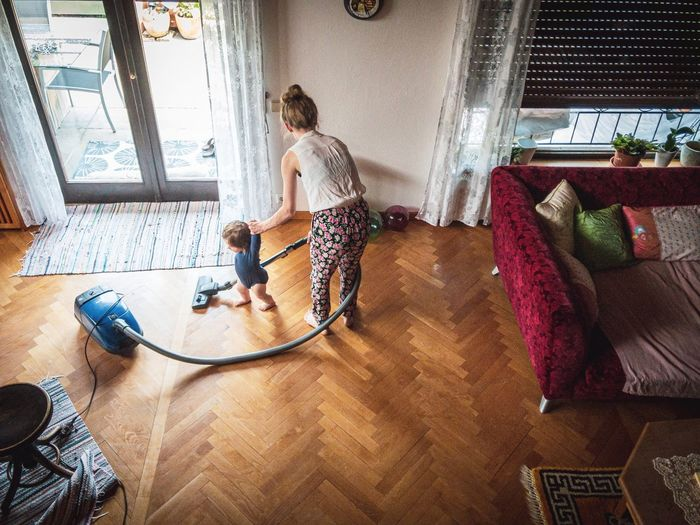 High angle view of people on hardwood floor at home