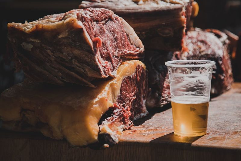 Close-Up Of Meat And Beer In Glass On Table