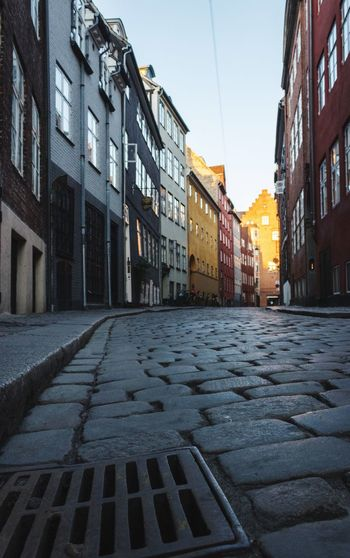 Old street Danish Architecture Danish Design Colorful Copenhagen Historic Old Building Exterior Architecture Built Structure City Street Building Sky Residential District Day No People Road The Way Forward Direction Clear Sky Footpath Outdoors Sunlight Transportation Cobblestone
