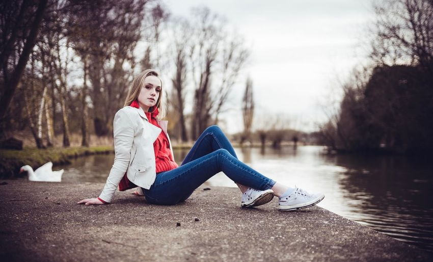Ffion2. White Shoes Red Jeans Swan One Person Full Length Young Adult Casual Clothing Lifestyles Young Women Leisure Activity Blond Hair Portrait Sitting Tree Women Outdoors