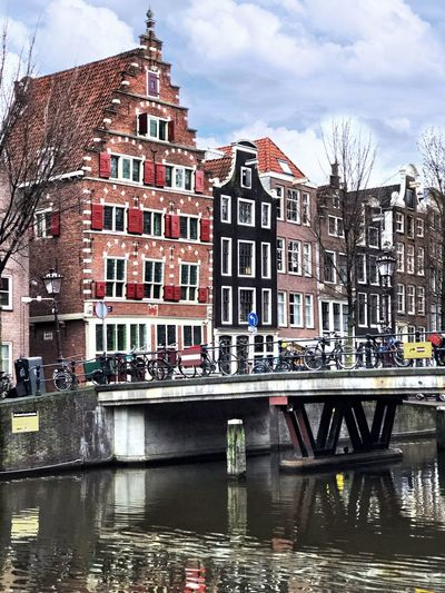 Historic centre Amsterdam Leaning Houses Bridge Canal Red Light District Amsterdam Dutch Holland Canal Ring Gables Step Gables Built Structure Architecture Building Exterior Building Water Sky City Cloud - Sky House Row House River Outdoors