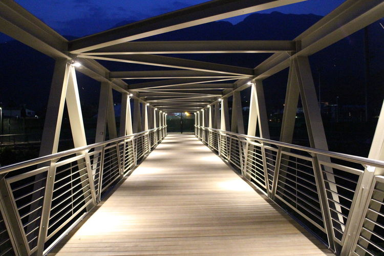 View of elevated walkway at night