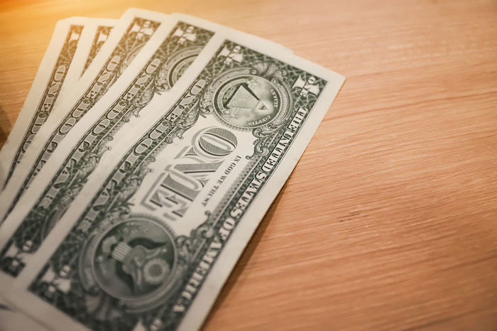 US dollar for everyday life,Money for shopping Rich Salary Shopping US Dollar USA USD Bank Banknote Buy Close-up Currency Day Dollar Finance High Angle View Indoors  Investment Money No People One Dollar  Paper Currency Pay Saving Table Wealth