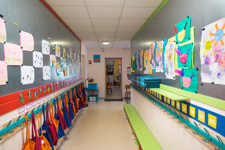 Preschooler Corridor School Bench Indoors  Multi Colored Illuminated Large Group Of Objects Education In A Row Choice Shopping Absence People Architecture Store Wall - Building Feature Variation Retail  Arrangement Shelf Ceiling Lighting Equipment Various Repetition Passage Hallway Passageway Architectural Design Collection