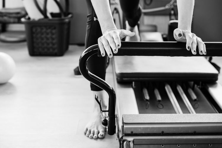 Training on Pilates reformer Blackandwhite Close-up Day Equipment Exercising Female Fine Art Photography Fitness Hands Indoors  Pilates Sport Training Woman Who Inspire You Workout