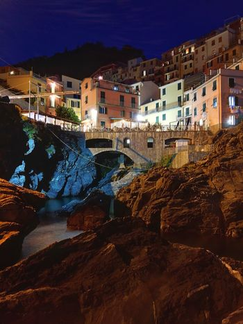 Evening in Manarola (Italy) Built Structure Architecture Building Exterior No People Illuminated Night City Sky Nature Outdoors Water Beauty In Nature Blue Hour In Manarola Manarola Blue Hour Cinqueterre Manarola Huawei P9 Night Shot