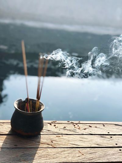 Dupa Focus On Foreground No People Nature Day Incense Outdoors Belief Close-up Spirituality Water Wood - Material Architecture Smoke - Physical Structure My Best Photo The Mobile Photographer - 2019 EyeEm Awards