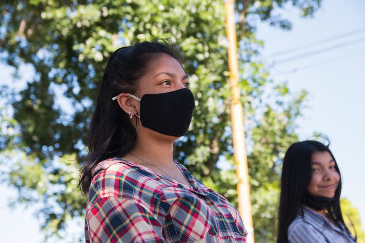Young women wearing face mask
