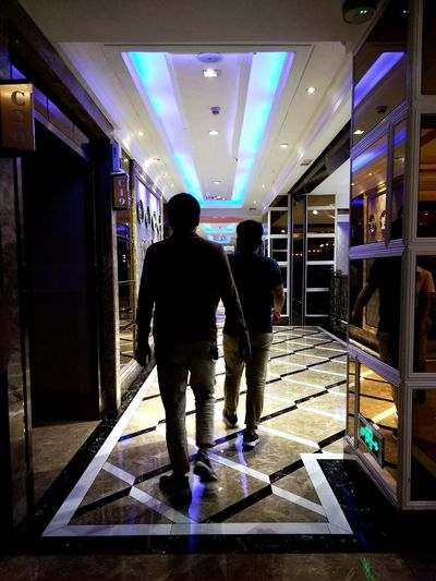 Rear View Full Length Two People Indoors  People Men Adult Illuminated Adults Only Only Men Architecture City Neon Cyberspace Day China Walking Mall Shopping Stores Luxury Luxury Hotel High End Retail Stores Indoors  China Culture