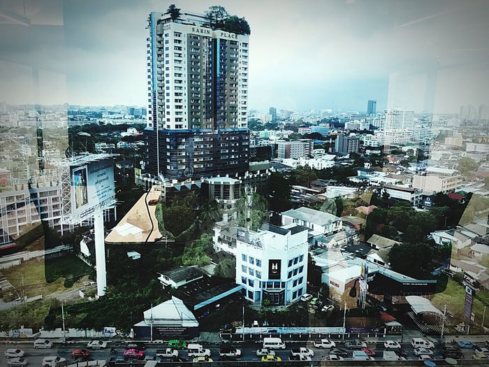 The view from my working room window is breathtaking!! taffic !! Architecture Building Exterior City Skyscraper Built Structure Cityscape Tall - High Tower Travel Destinations Crowded City Life Modern Outdoors Day Car Sky Urban Skyline Tall People Taffic Thailand Bangkok Thailand.