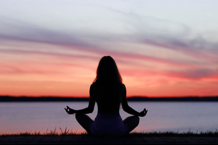 girl and sunset People Female Tranquility Calm Girl Woman Relax Relaxation Meditation Copy Space. Water Sunset Beauty Portrait Silhouette Reflection Lake Sky Landscape Lotus Position Cross-legged Relaxation Exercise Yoga Back Position Zen-like Yoga Studio Meditating Yoga Class Human Back