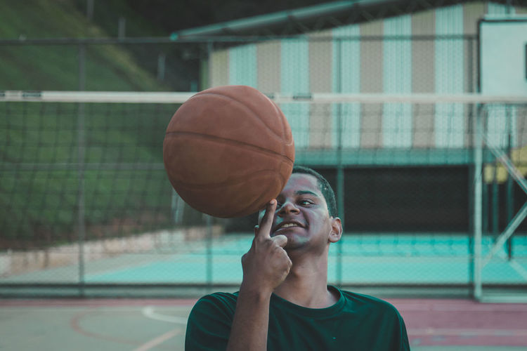 Close-up of man with basketball