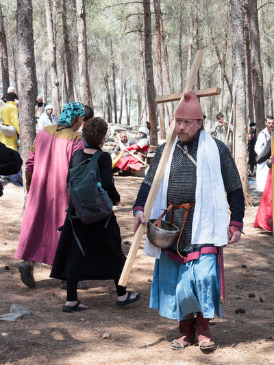Tiberias, Israel, July 01, 2017 : Participant in the reconstruction of Horns of Hattin battle in 1187 goes through the camp before the campaign near Tiberias, Israel 1187 Battle Cross Crusaders Day Field Guy De Lusignan Hattin Heat Heritage History Horn Israel Jerusalem KINGDOM Muslims Outdoors Palestine People Reconstruction Religion Saladin Templars War Weapons