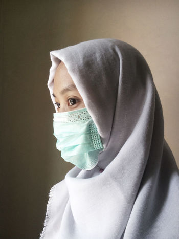 Hijab women with surgical mask Black Eyes Close-up Facial Mask - Beauty Product Healthcare And Medicine Hijab Hospital Human Face Hygiene Indoors  Looking At Camera One Person People Portrait Real People Scarf Surgical Cap Surgical Mask Young Adult Young Women