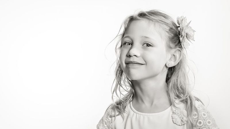 Portrait Blond Hair Child Studio Shot One Girl Only Portrait Headshot Children Only Girls Childhood White Background Looking At Camera One Person Beauty Happiness Cheerful People Close-up Human Body Part Desaturated Day