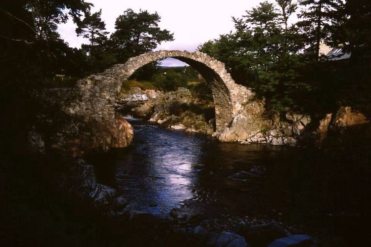 The old packhorse bridge in Carrbridge. The bridge built in 1717, is the oldest stone bridge in the Highlands of Scotland. It was severely damaged in 1892 which left it in the condition seen today. It is now unstable and is recommended only to be viewed from afar. Jumping of the bridge into the River Dulnair below had long been a popular pastime for the younger locals and the more adventurous tourists. Source Wikipedia. Bridge Ruins