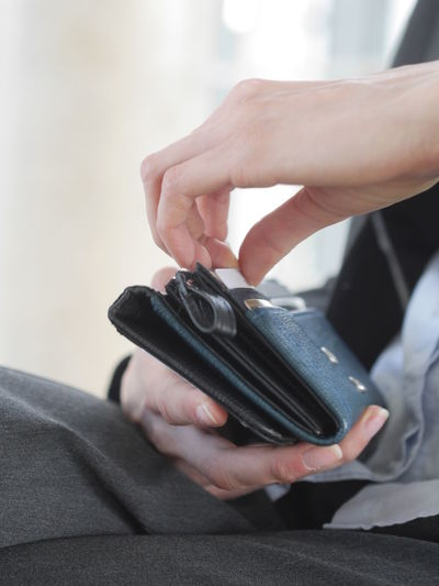 Midsection of woman removing credit card in shop